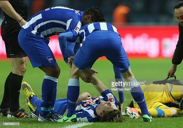 Peter Niemeyer of Berlin is injured during the Second Bundesliga match between Hertha BSC Berlin and Eintracht Braunschweig at Olympic stadium on...