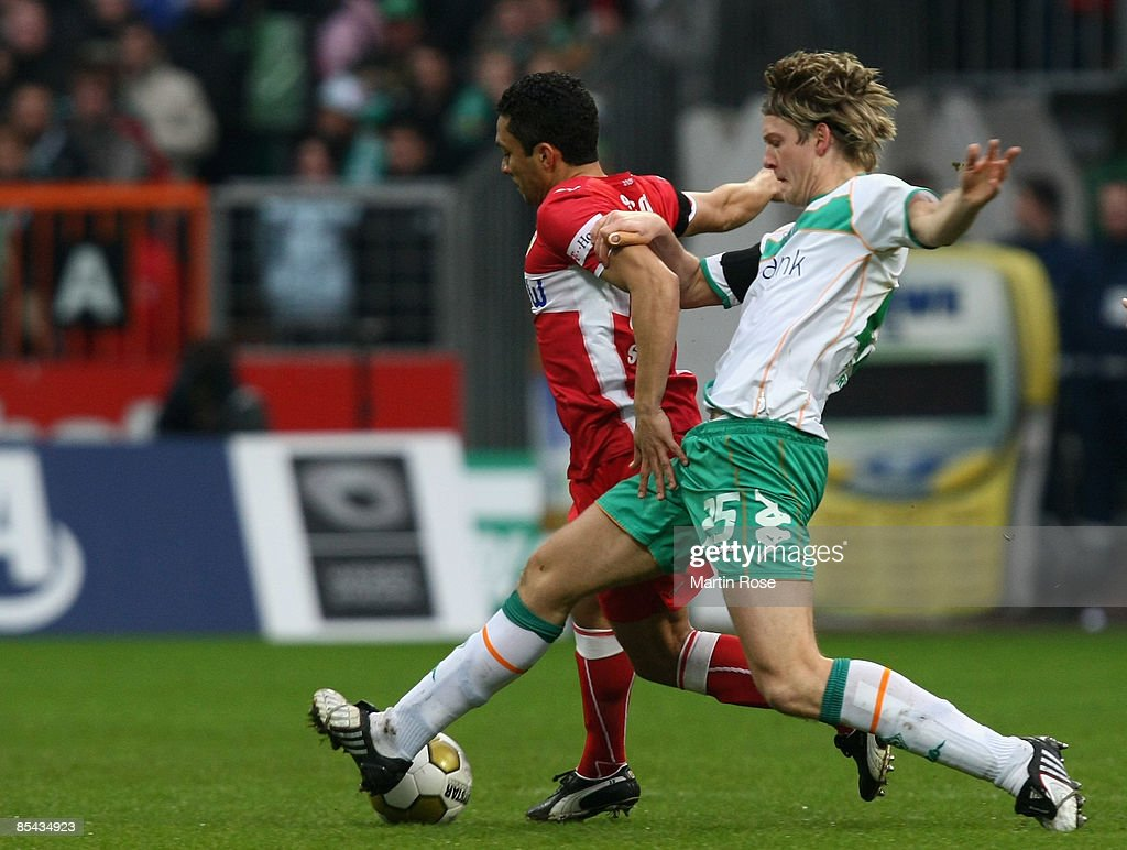 Peter Niemeyer (R) of Bremen and Elson (R) of Stuttgart battle for the ball during the Bundesliga match between Werder Bremen and VfB Stuttgart at the Weser stadium on March 15, 2009 in Bremen, Germany.
