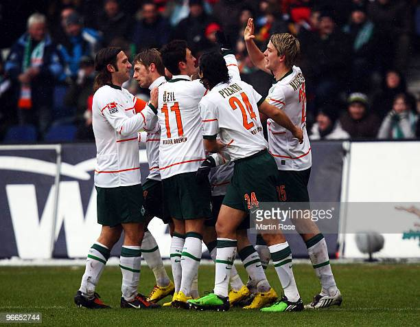 Peter Niemeyer of Bremen celebrate with his team mates after he scores his team's 1st goal during the Bundesliga match between Hannover 96 and SV...