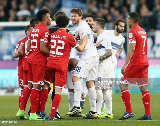 Peter Niemeyer of Darmstadt and Andre Ramalho of Mainz argue during the Bundesliga match between SV Darmstadt 98 and 1 FSV Mainz 05 at...