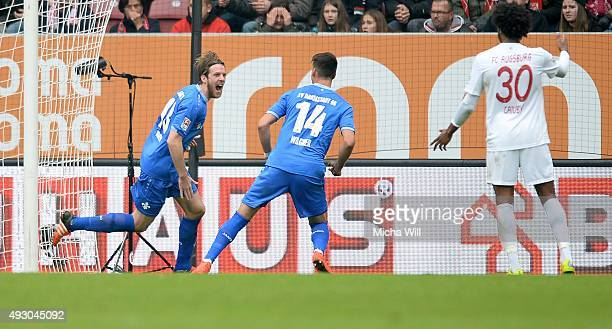 Peter Niemeyer of Darmstadt celebrates after scoring his team's second goal during the Bundesliga match between FC Augsburg and SV Darmstadt 98 at...