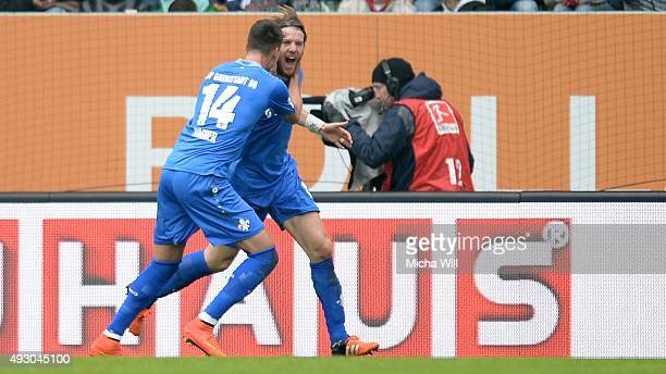 Peter Niemeyer of Darmstadt celebrates with Sandro Wagner of Darmstadt after scoring his team's second goal during the Bundesliga match between FC...