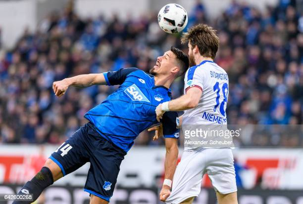 Peter Niemeyer of Darmstadt challenges Sandro Wagner of Hoffenheim during the Bundesliga match between TSG 1899 Hoffenheim and SV Darmstadt 98 at...