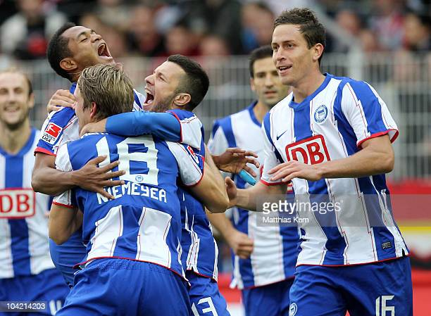 Peter Niemeyer of Hertha jubilates with team mates after scoring the first goal during the Second Bundesliga match between 1FC Union Berlin and...