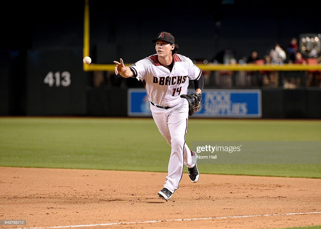 Peter O'Brien #14 of the Arizona Diamondbacks flips the ball to first base against the Philadelphia Phillies at Chase Field on June 27, 2016 in Phoenix, Arizona.