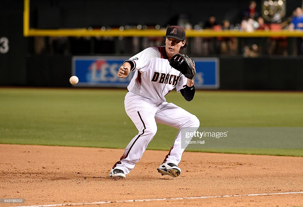 Peter O'Brien #14 of the Arizona Diamondbacks makes a play on a bouncing ball against the Philadelphia Phillies at Chase Field on June 27, 2016 in Phoenix, Arizona.
