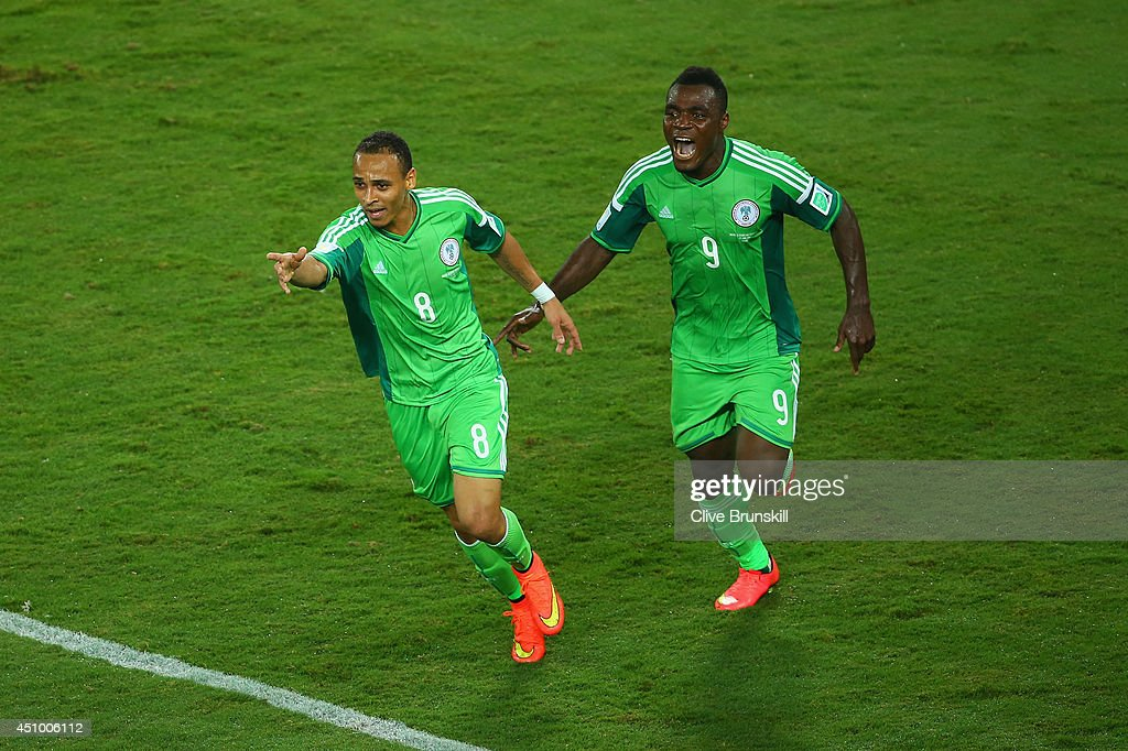 <a gi-track='captionPersonalityLinkClicked' href=/galleries/search?phrase=Peter+Odemwingie&family=editorial&specificpeople=648594 ng-click='$event.stopPropagation()'>Peter Odemwingie</a> of Nigeria (L) celebrates scoring his team's first goal with teammate <a gi-track='captionPersonalityLinkClicked' href=/galleries/search?phrase=Emmanuel+Emenike&family=editorial&specificpeople=7487637 ng-click='$event.stopPropagation()'>Emmanuel Emenike</a> during the 2014 FIFA World Cup Group F match between Nigeria and Bosnia-Herzegovina at Arena Pantanal on June 21, 2014 in Cuiaba, Brazil.
