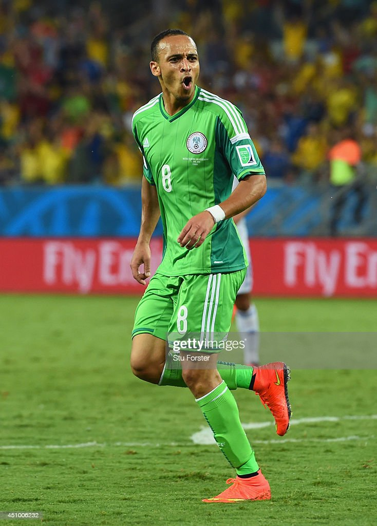 <a gi-track='captionPersonalityLinkClicked' href=/galleries/search?phrase=Peter+Odemwingie&family=editorial&specificpeople=648594 ng-click='$event.stopPropagation()'>Peter Odemwingie</a> of Nigeria celebrates scoring his team's first goal during the 2014 FIFA World Cup Group F match between Nigeria and Bosnia-Herzegovina at Arena Pantanal on June 21, 2014 in Cuiaba, Brazil.