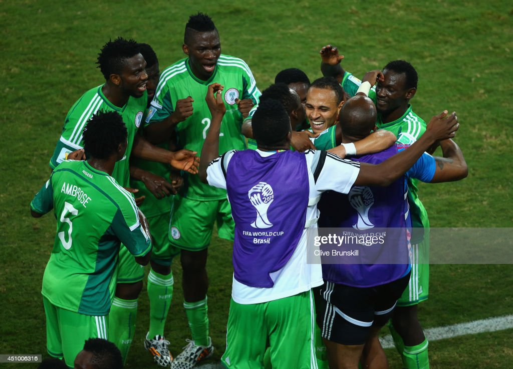 Peter Odemwingie of Nigeria (C) celebrates scoring his team's first goal with teammates during the 2014 FIFA World Cup Group F match between Nigeria and Bosnia-Herzegovina at Arena Pantanal on June 21, 2014 in Cuiaba, Brazil.