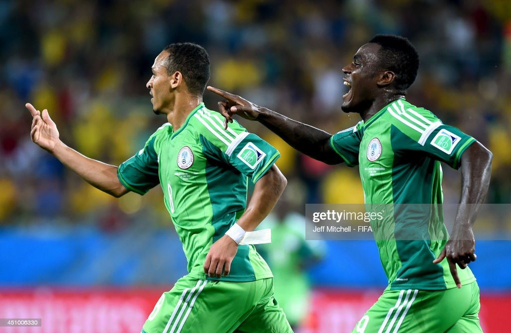 Peter Odemwingie (L) of Nigeria celebrates scoring his team's first goal with his teammate Emmanuel Emenike during the 2014 FIFA World Cup Brazil Group F match between Nigeria and Bosnia-Herzegovina at Arena Pantanal on June 21, 2014 in Cuiaba, Brazil.