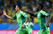 Peter Odemwingie of Nigeria celebrates scoring his team's first goal with his teammate Emmanuel Emenike during the 2014 FIFA World Cup Brazil Group F...