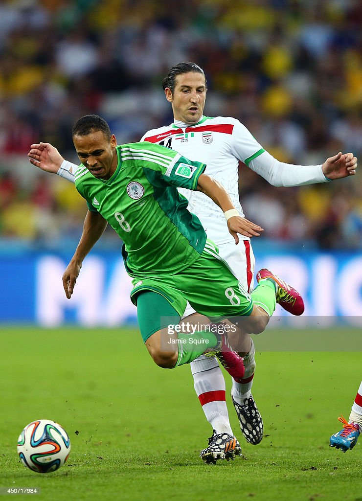 <a gi-track='captionPersonalityLinkClicked' href=/galleries/search?phrase=Peter+Odemwingie&family=editorial&specificpeople=648594 ng-click='$event.stopPropagation()'>Peter Odemwingie</a> of Nigeria falls after a challenge by <a gi-track='captionPersonalityLinkClicked' href=/galleries/search?phrase=Andranik+Teymourian&family=editorial&specificpeople=551220 ng-click='$event.stopPropagation()'>Andranik Teymourian</a> of Iran during the 2014 FIFA World Cup Brazil Group F match between Iran and Nigeria at Arena da Baixada on June 16, 2014 in Curitiba, Brazil.