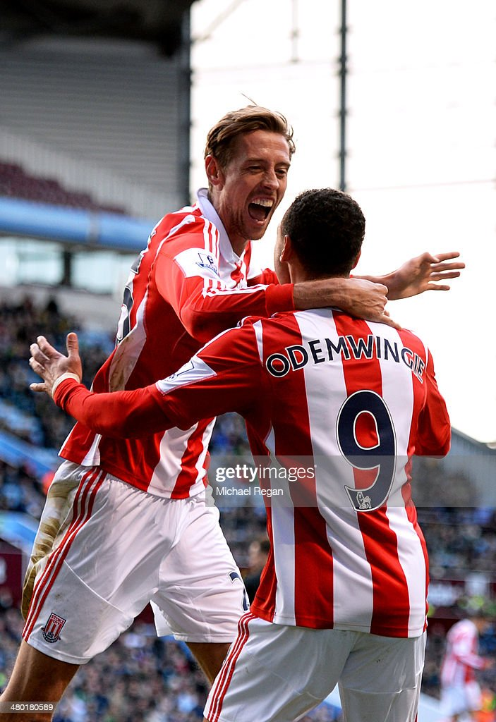<a gi-track='captionPersonalityLinkClicked' href=/galleries/search?phrase=Peter+Odemwingie&family=editorial&specificpeople=648594 ng-click='$event.stopPropagation()'>Peter Odemwingie</a> (R) of Stoke celebrates with teammate <a gi-track='captionPersonalityLinkClicked' href=/galleries/search?phrase=Peter+Crouch&family=editorial&specificpeople=210764 ng-click='$event.stopPropagation()'>Peter Crouch</a> (L)after scoring a goal to level the scores at 1-1 during the Barclays Premier League match between Aston Villa and Stoke City at Villa Park on March 23, 2014 in Birmingham, England.