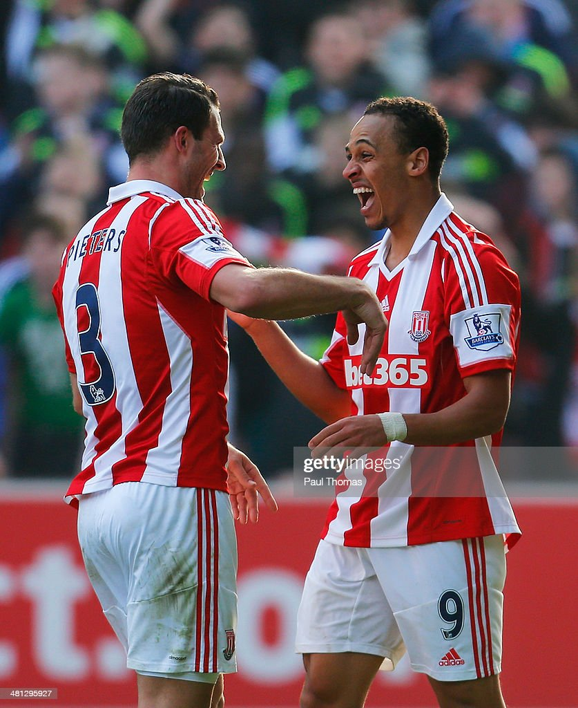 Peter Odemwingie (R) of Stoke City celebrates his goal with Erik Pieters of Stoke City during the Barclays Premier League match between Stoke City and Hull City at Britannia Stadium on March 29, 2014 in Stoke on Trent, England.