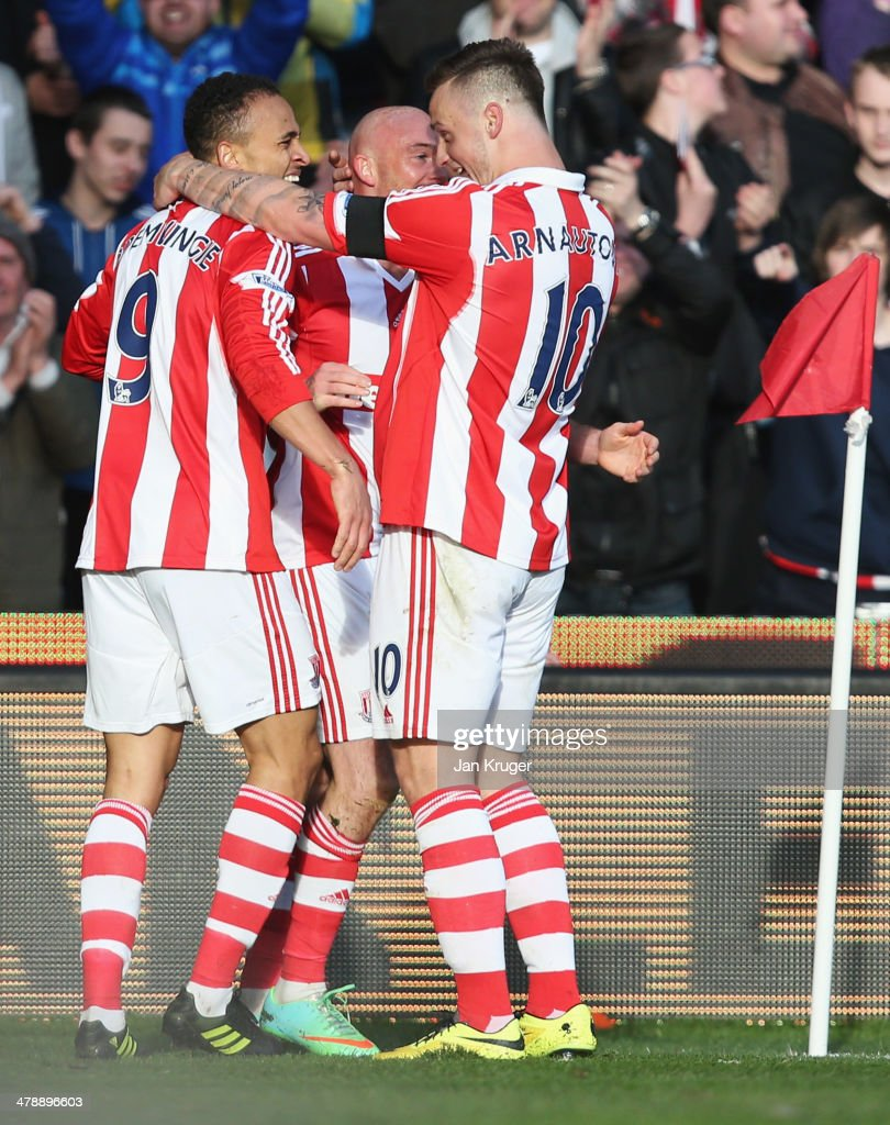 Peter Odemwingie of Stoke City (L) celebrates with Stephen Ireland (C) and Marko Arnautovic (R) as he scores their third goal during the Barclays Premier League match between Stoke City and West Ham United at Britannia Stadium on March 15, 2014 in Stoke on Trent, England.