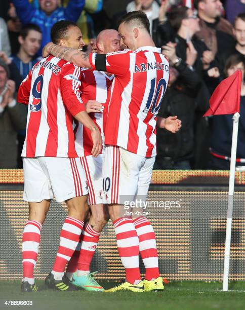 Peter Odemwingie of Stoke City celebrates with Stephen Ireland and Marko Arnautovic as he scores their third goal during the Barclays Premier League...