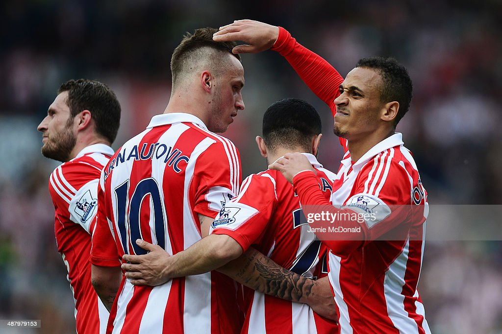 <a gi-track='captionPersonalityLinkClicked' href=/galleries/search?phrase=Peter+Odemwingie&family=editorial&specificpeople=648594 ng-click='$event.stopPropagation()'>Peter Odemwingie</a> (R) of Stoke City celebrates with team mates after scoring during the Barclays Premier League match between Stoke City and Fulham at the Britannia Stadium on May 3, 2014 in Stoke on Trent, England.