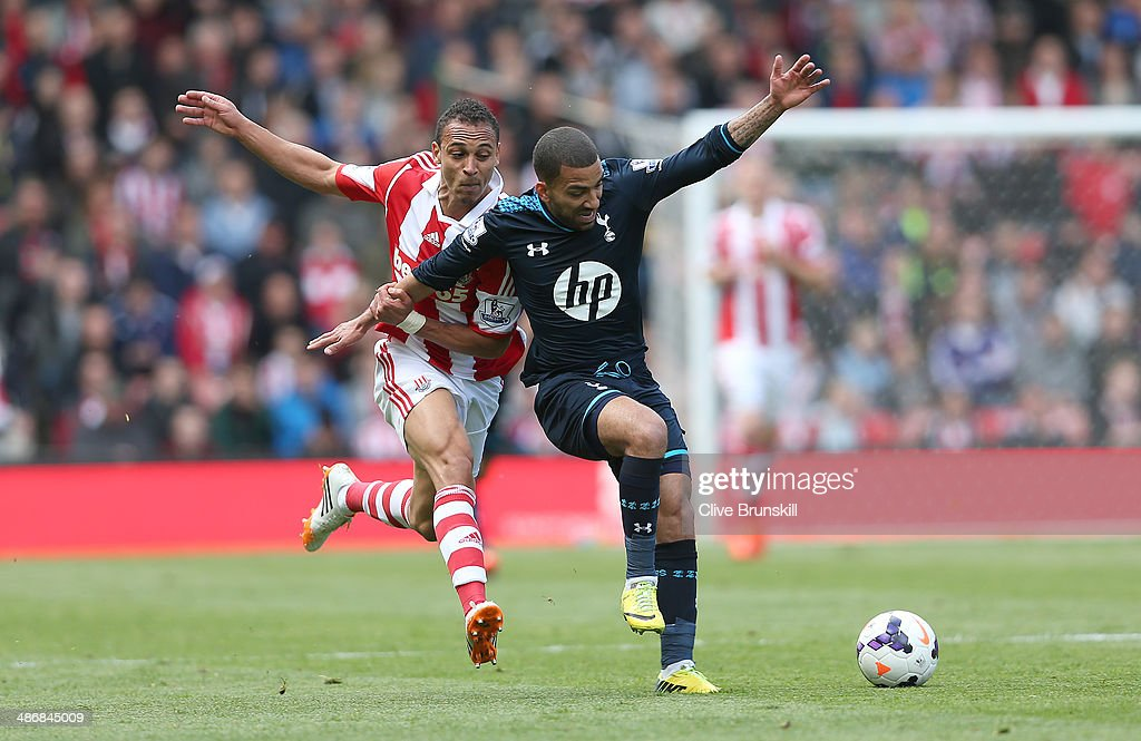 <a gi-track='captionPersonalityLinkClicked' href=/galleries/search?phrase=Peter+Odemwingie&family=editorial&specificpeople=648594 ng-click='$event.stopPropagation()'>Peter Odemwingie</a> of Stoke City in action with <a gi-track='captionPersonalityLinkClicked' href=/galleries/search?phrase=Aaron+Lennon&family=editorial&specificpeople=453309 ng-click='$event.stopPropagation()'>Aaron Lennon</a> of Tottenham Hotspur during the Barclays Premier League match between Stoke City and Tottenham Hotspur at the Britannia Stadium on April 26, 2014 in Stoke on Trent, England.