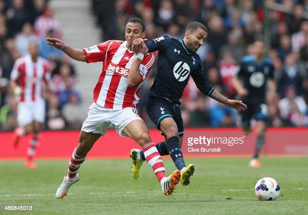 Peter Odemwingie of Stoke City in action with Aaron Lennon of Tottenham Hotspur during the Barclays Premier League match between Stoke City and...