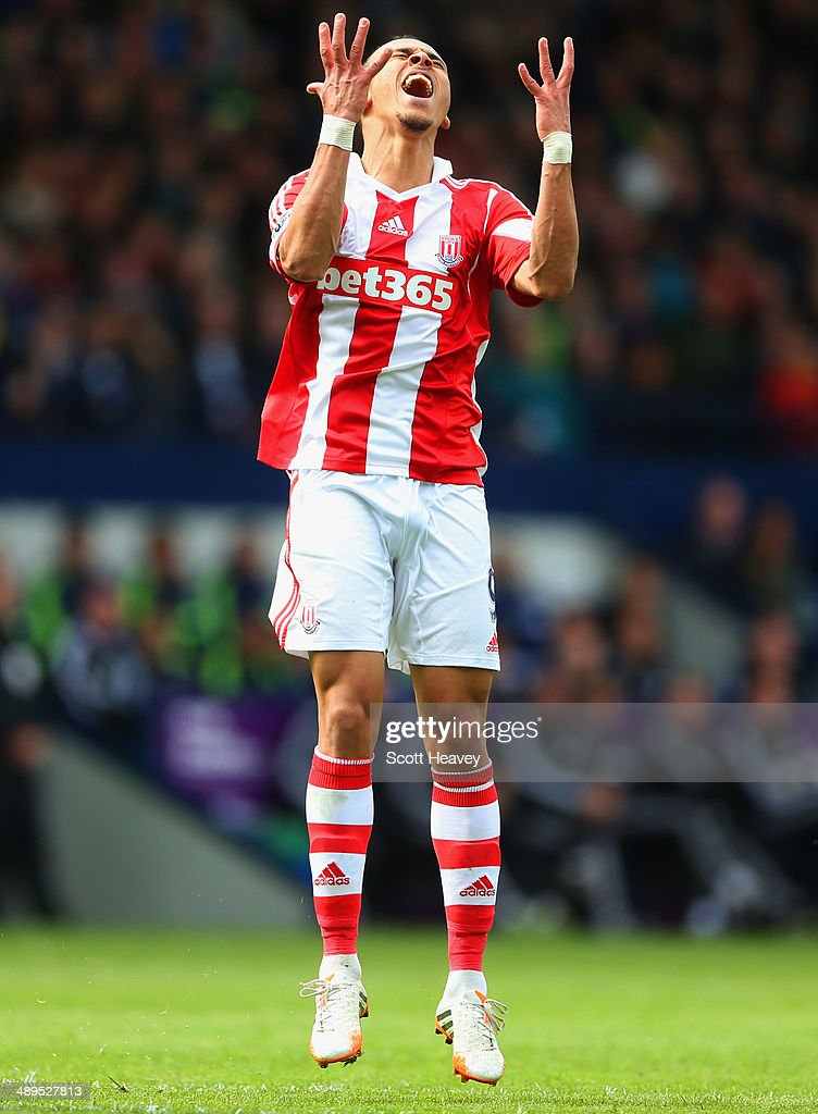 <a gi-track='captionPersonalityLinkClicked' href=/galleries/search?phrase=Peter+Odemwingie&family=editorial&specificpeople=648594 ng-click='$event.stopPropagation()'>Peter Odemwingie</a> of Stoke City reacts during the Barclays Premier League match between West Bromwich Albion and Stoke City at The Hawthorns on May 11, 2014 in West Bromwich, England.