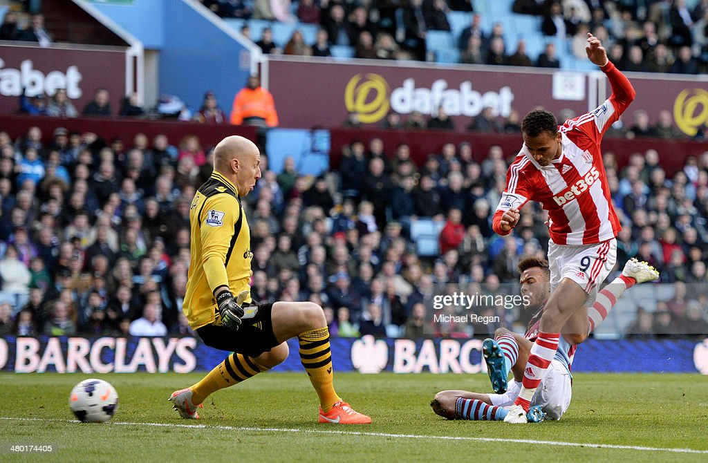 <a gi-track='captionPersonalityLinkClicked' href=/galleries/search?phrase=Peter+Odemwingie&family=editorial&specificpeople=648594 ng-click='$event.stopPropagation()'>Peter Odemwingie</a> of Stoke shoots past goalkeeper <a gi-track='captionPersonalityLinkClicked' href=/galleries/search?phrase=Brad+Guzan&family=editorial&specificpeople=662127 ng-click='$event.stopPropagation()'>Brad Guzan</a> of Aston Villa to score a goal to level the scores at 1-1 during the Barclays Premier League match between Aston Villa and Stoke City at Villa Park on March 23, 2014 in Birmingham, England.