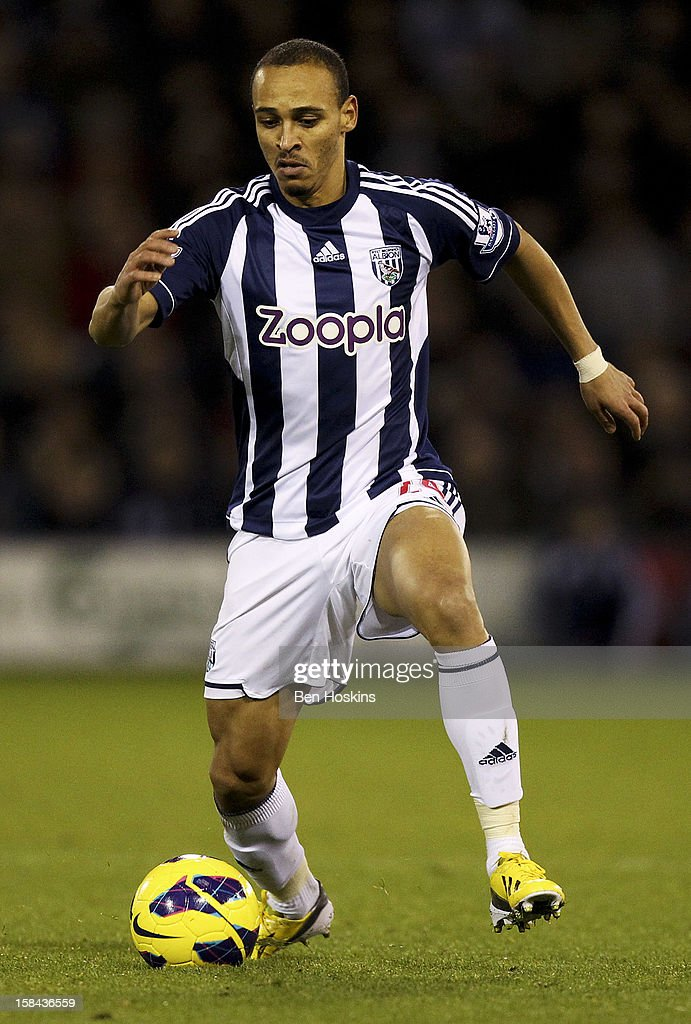 <a gi-track='captionPersonalityLinkClicked' href=/galleries/search?phrase=Peter+Odemwingie&family=editorial&specificpeople=648594 ng-click='$event.stopPropagation()'>Peter Odemwingie</a> of West Brom in action during the Barclays Premier League match between West Bromwich Albion and West Ham United at the Hawthorns on December 16, 2012 in West Bromwich, England.