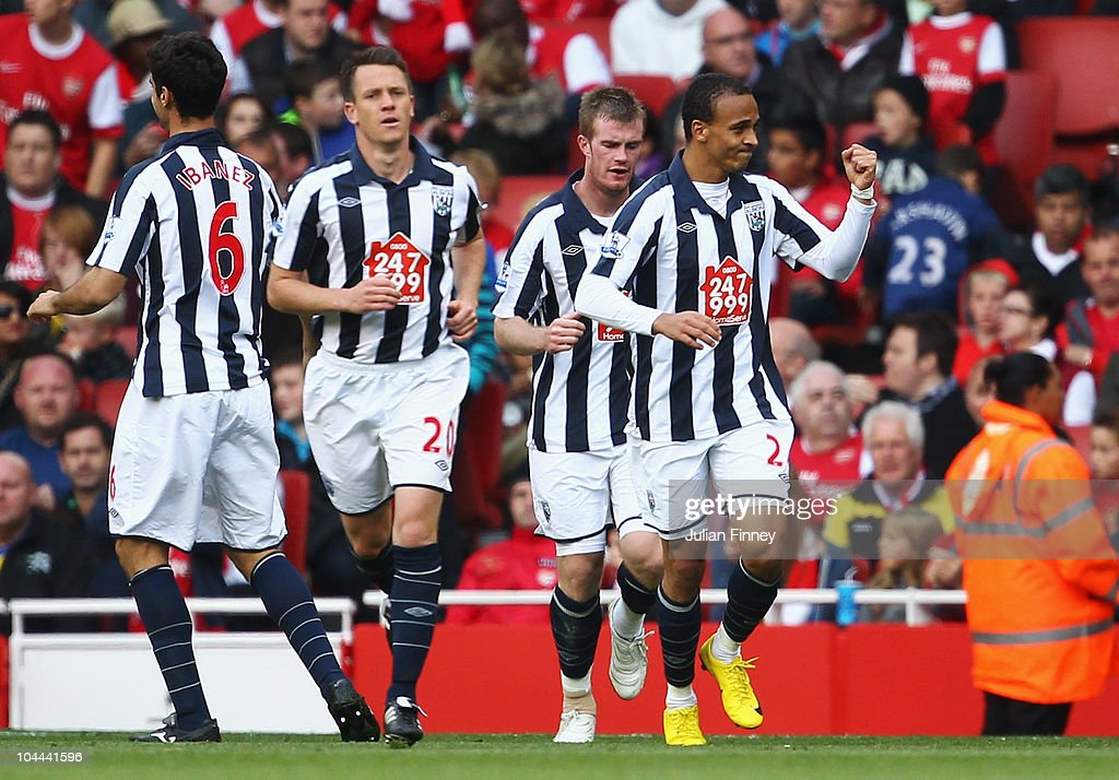 <a gi-track='captionPersonalityLinkClicked' href=/galleries/search?phrase=Peter+Odemwingie&family=editorial&specificpeople=648594 ng-click='$event.stopPropagation()'>Peter Odemwingie</a> of West Bromwich Albion (R) celebrates as he scores their first goal during the Barclays Premier League match between Arsenal and West Bromwich Albion at the Emirates Stadium on September 25, 2010 in London, England.