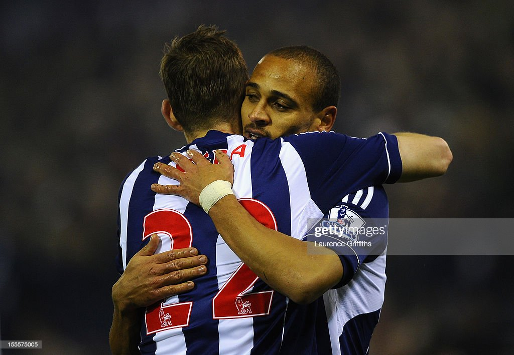 <a gi-track='captionPersonalityLinkClicked' href=/galleries/search?phrase=Peter+Odemwingie&family=editorial&specificpeople=648594 ng-click='$event.stopPropagation()'>Peter Odemwingie</a> of West Bromwich Albion celebrates scoring his team's second goal with team-mate <a gi-track='captionPersonalityLinkClicked' href=/galleries/search?phrase=Zoltan+Gera&family=editorial&specificpeople=216370 ng-click='$event.stopPropagation()'>Zoltan Gera</a> during the Barclays Premier League match between West Bromwich Albion and Southampton at The Hawthorns on November 5, 2012 in West Bromwich, England.