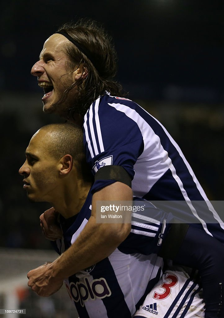 <a gi-track='captionPersonalityLinkClicked' href=/galleries/search?phrase=Peter+Odemwingie&family=editorial&specificpeople=648594 ng-click='$event.stopPropagation()'>Peter Odemwingie</a> of West Bromwich Albion celebrates scoring their second goal with Jonas Olsson of West Bromwich Albion during the Barclays Premier League match between West Bromwich Albion and Aston Villa at The Hawthorns on January 19, 2013 in West Bromwich, England.