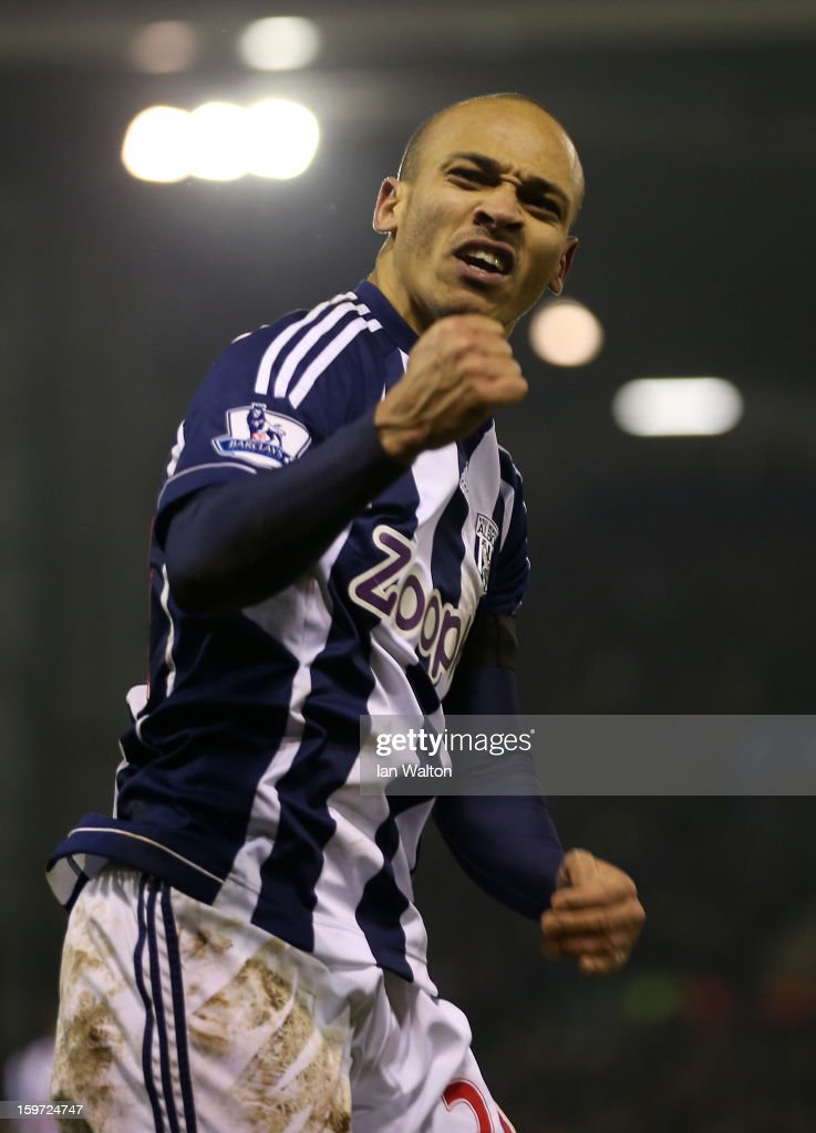 <a gi-track='captionPersonalityLinkClicked' href=/galleries/search?phrase=Peter+Odemwingie&family=editorial&specificpeople=648594 ng-click='$event.stopPropagation()'>Peter Odemwingie</a> of West Bromwich Albion celebrates scoring their second goal during the Barclays Premier League match between West Bromwich Albion and Aston Villa at The Hawthorns on January 19, 2013 in West Bromwich, England.