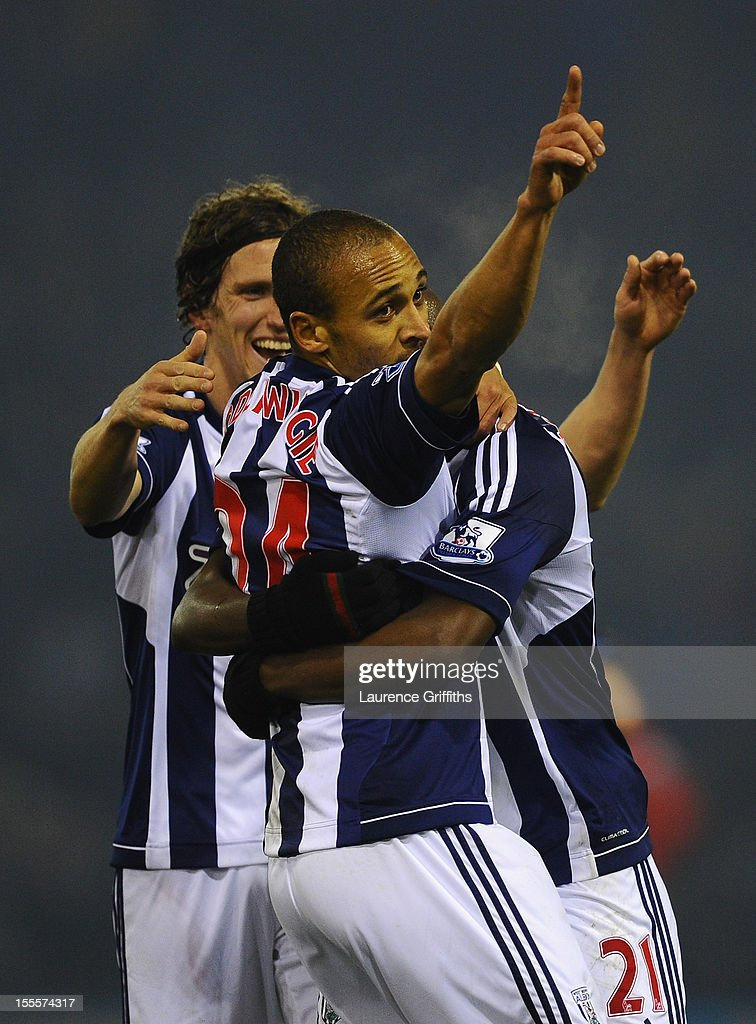 <a gi-track='captionPersonalityLinkClicked' href=/galleries/search?phrase=Peter+Odemwingie&family=editorial&specificpeople=648594 ng-click='$event.stopPropagation()'>Peter Odemwingie</a> of West Bromwich Albion is congratulated by his team-mates after scoring the opening goal during the Barclays Premier League match between West Bromwich Albion and Southampton at The Hawthorns on November 5, 2012 in West Bromwich, England.