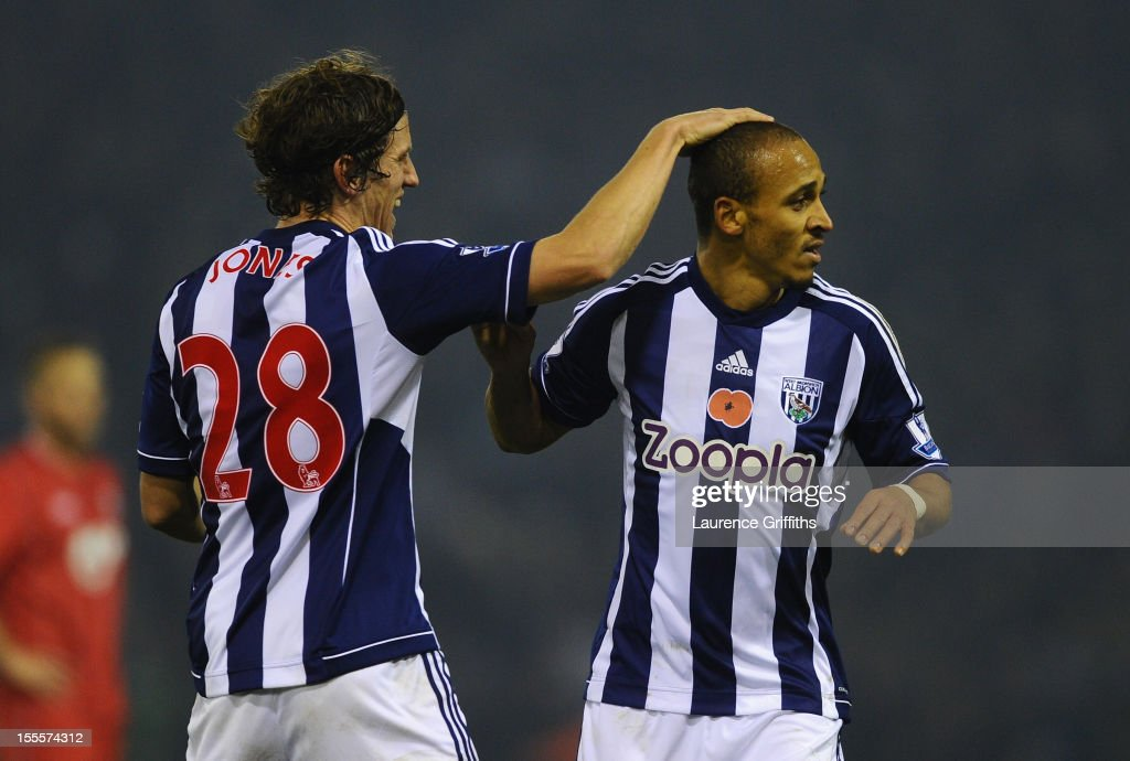 <a gi-track='captionPersonalityLinkClicked' href=/galleries/search?phrase=Peter+Odemwingie&family=editorial&specificpeople=648594 ng-click='$event.stopPropagation()'>Peter Odemwingie</a> of West Bromwich Albion is congratulated by team-mate Billy Jones after scoring the opening goal during the Barclays Premier League match between West Bromwich Albion and Southampton at The Hawthorns on November 5, 2012 in West Bromwich, England.