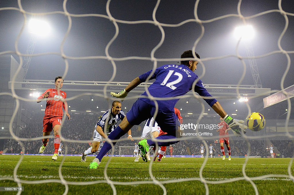 <a gi-track='captionPersonalityLinkClicked' href=/galleries/search?phrase=Peter+Odemwingie&family=editorial&specificpeople=648594 ng-click='$event.stopPropagation()'>Peter Odemwingie</a> of West Bromwich Albion scores his team's second goal past the dive of Paulo Gazzaniga of Southampton during the Barclays Premier League match between West Bromwich Albion and Southampton at The Hawthorns on November 5, 2012 in West Bromwich, England.