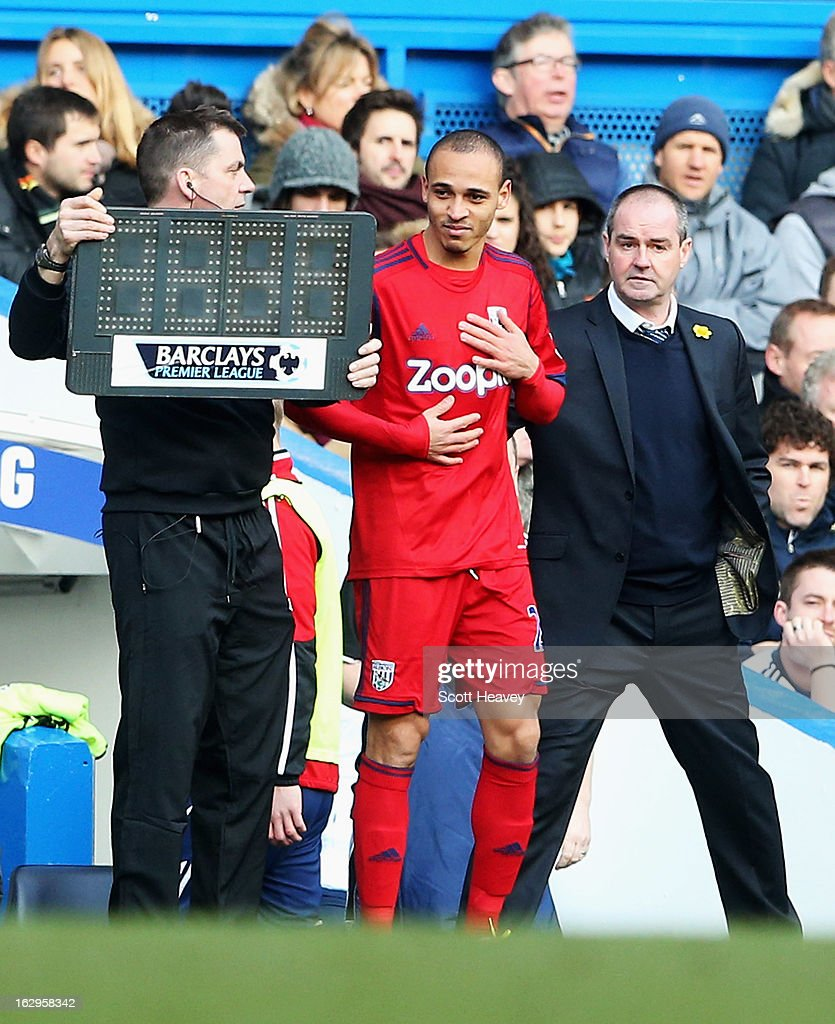 Peter Odemwingie of West Bromwich Albion stands with manager Steve Clarke as he prepares to come on as a substitute during the Barclays Premier League match between Chelsea and West Bromwich Albion at Stamford Bridge on March 2, 2013 in London, England.