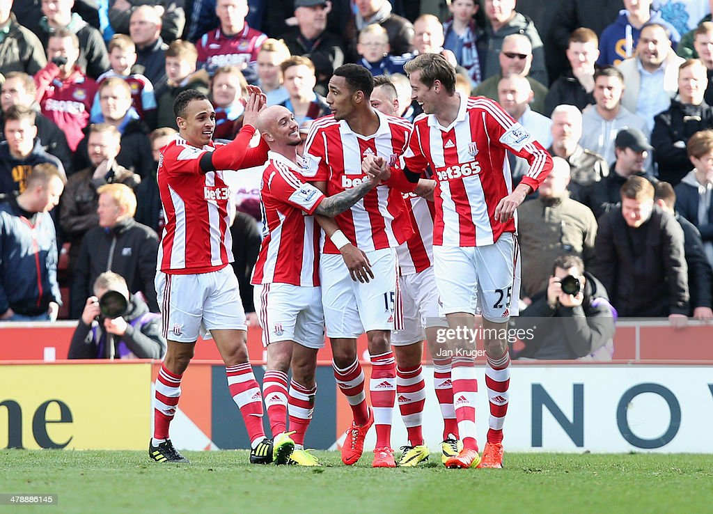 Peter Odemwingie, Stephen Ireland, Steven N'Zonzi and Peter Crouch of Stoke City celebrate as Crouch's shot deflects into the goal off of Odemwingie for their first goal during the Barclays Premier League match between Stoke City and West Ham United at Britannia Stadium on March 15, 2014 in Stoke on Trent, England.