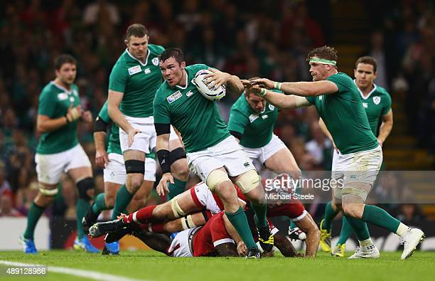 Peter O'Mahony of Ireland breaks a tackle during the 2015 Rugby World Cup Pool D match between Ireland and Canada at the Millennium Stadium on...