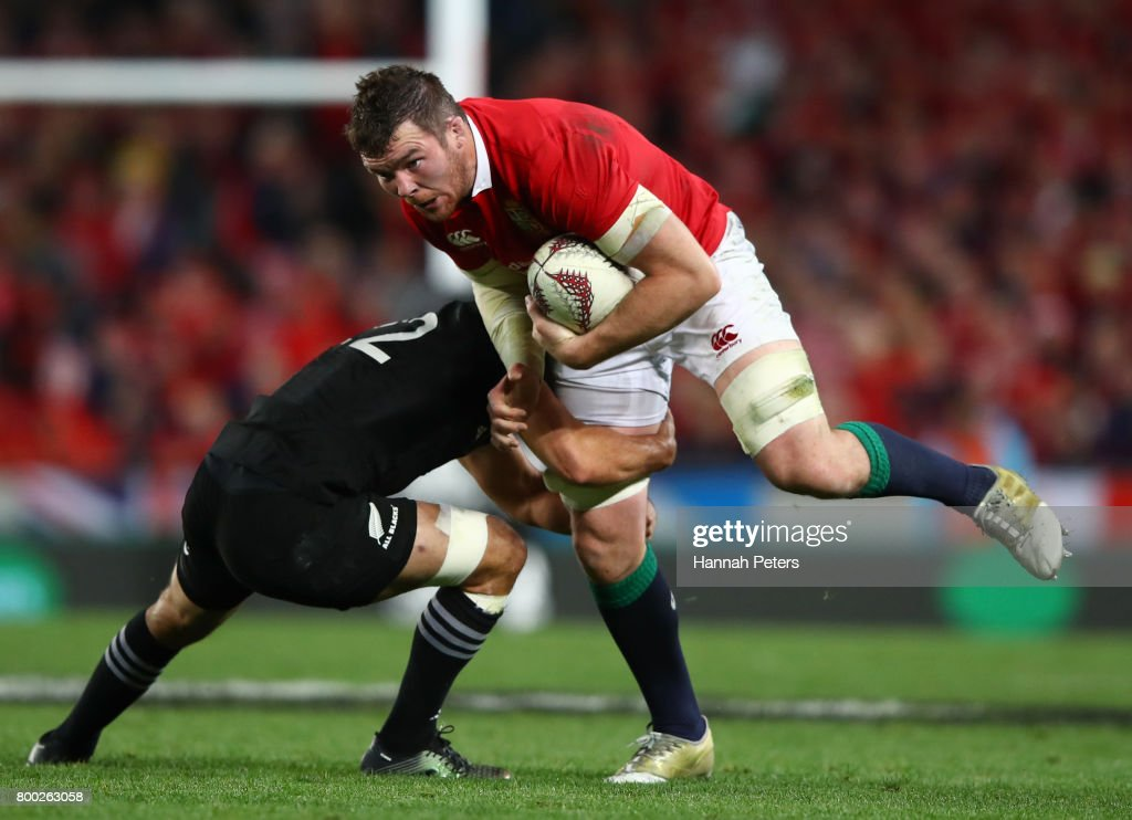 Peter O'Mahony of the Lions is tackled by Aaron Cruden of the All Blacks / Lima Sopoaga of the All Blacks during the first test match between the New Zealand All Blacks and the British & Irish Lions at Eden Park on June 24, 2017 in Auckland, New Zealand.