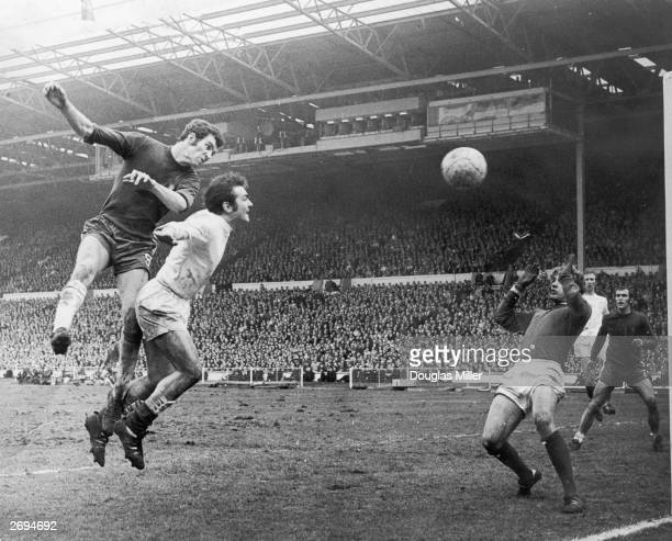 Peter Osgood of Chelsea beats the Leeds United footballer Terry Cooper to the ball during the FA Cup final while Leeds defender Jack Charlton looks on