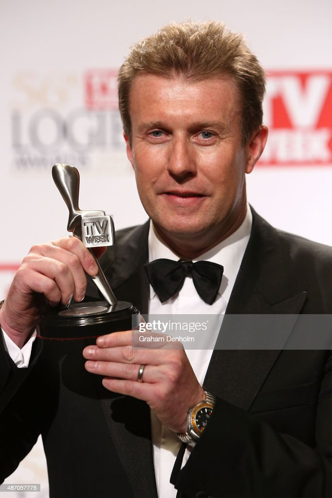 <a gi-track='captionPersonalityLinkClicked' href=/galleries/search?phrase=Peter+Overton&family=editorial&specificpeople=223969 ng-click='$event.stopPropagation()'>Peter Overton</a> poses in the awards room after winning a Logie for Outstanding News Coverage at the 2014 Logie Awards at Crown Palladium on April 27, 2014 in Melbourne, Australia.