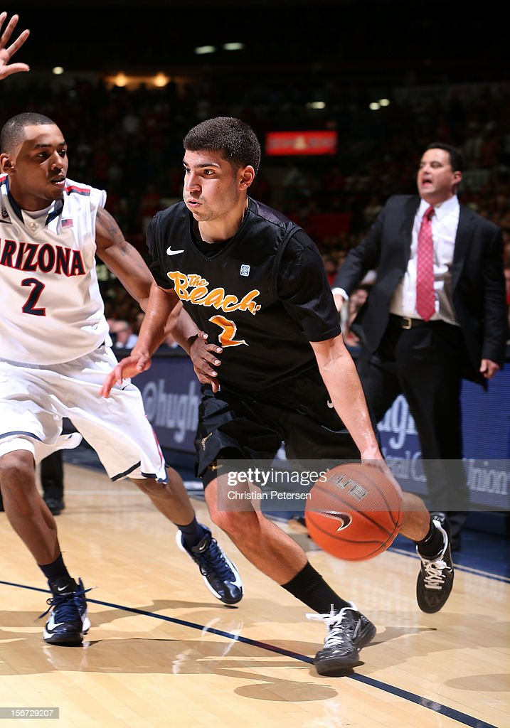 Peter Pappageorge #2 of the Long Beach State 49ers handles the ball under pressure from Mark Lyons #2 of the Arizona Wildcats during the college basketball game at McKale Center on November 19, 2012 in Tucson, Arizona. The Wildcats defeated the 49ers 94-72.