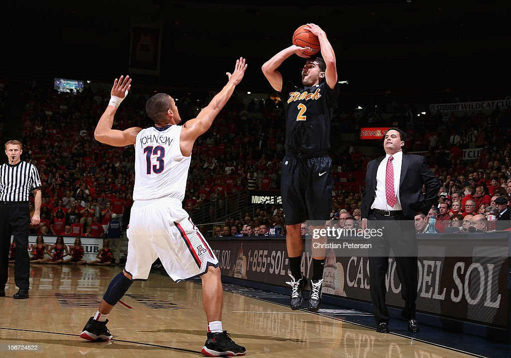 Peter Pappageorge #2 of the Long Beach State 49ers puts up a shot over Nick Johnson #13 of the Arizona Wildcats during the first half of the college basketball game at McKale Center on November 19, 2012 in Tucson, Arizona.