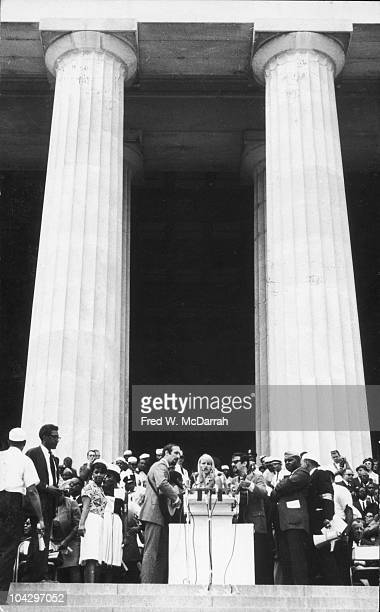 American folk and pop group Peter Paul and Mary perform on the steps of the Lincoln Memorial during the March on Washington for Jobs and Freedom...