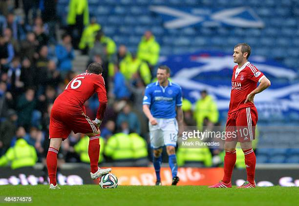 Peter Pawlett and Naill McGuinn wait to to kick off again after St Johnstone's winning goal during the William Hill Scottish Cup Semi Final between...
