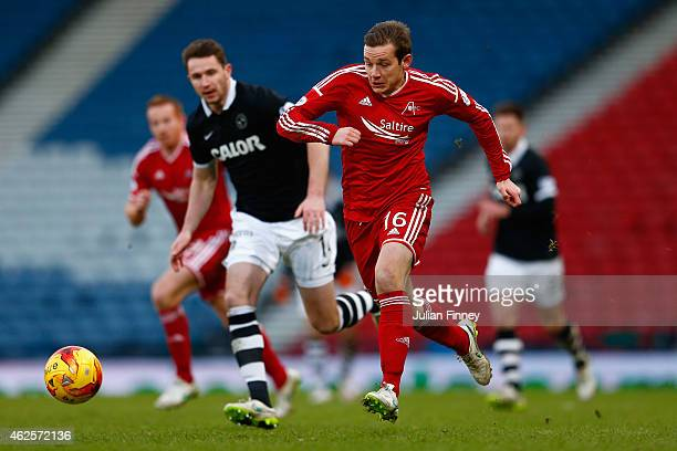 Peter Pawlett of Aberdeen goes past Callum Morris of Dundee Utd during the Scottish League Cup SemiFinal match between Dundee United and Aberdeen at...
