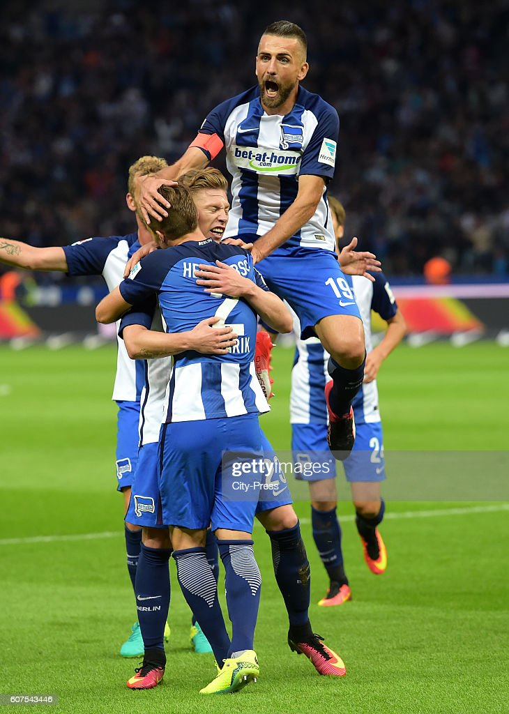 Peter Pekarik, Mitchell Weiser and Vedad Ibisevic of Hertha BSC celebrate after scoring the 1:0 during the game between Hertha BSC and FC Schalke 04 on September 18, 2016 in Berlin, Germany.