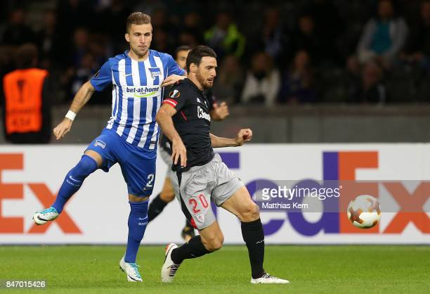 Peter Pekarik of Berlin battles for the ball with Aritz Aduriz of Bilbao during the UEFA Europa League group J match between Hertha BSC and Athletic...