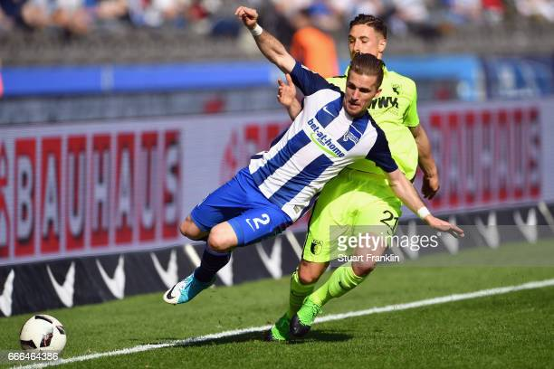 Peter Pekarik of Berlin is challenged by Dominik Kohr of Augsburg during the Bundesliga match between Hertha BSC and FC Augsburg at Olympiastadion on...