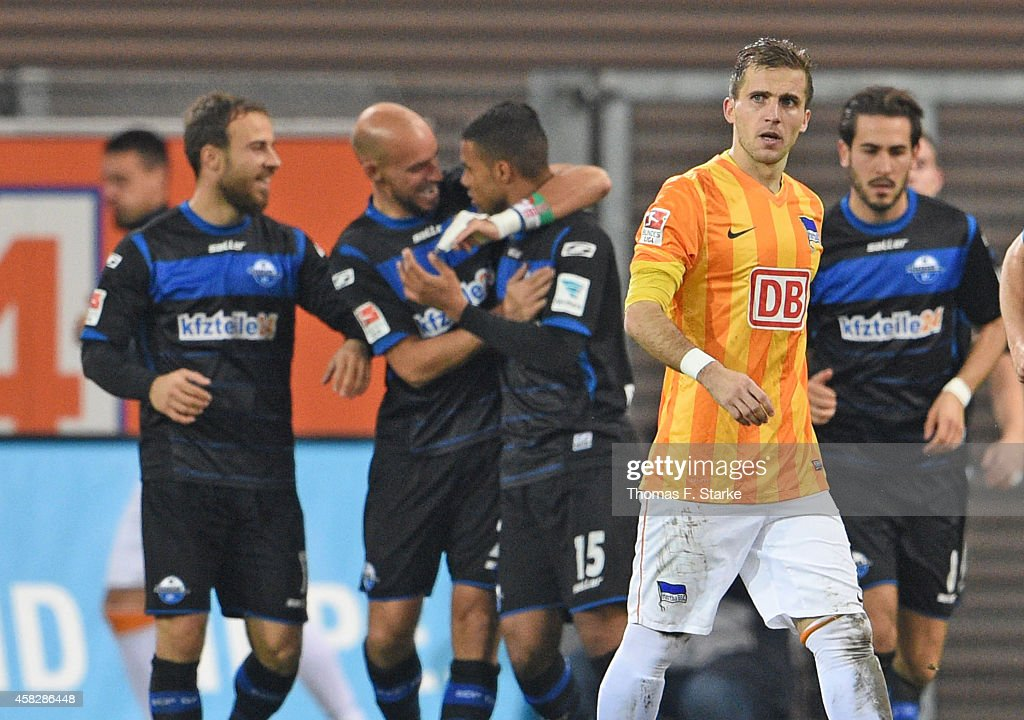 Peter Pekarik of Berlin looks dejected while players of Paderborn celebrate in the background during the Bundesliga match between SC Paderborn and...