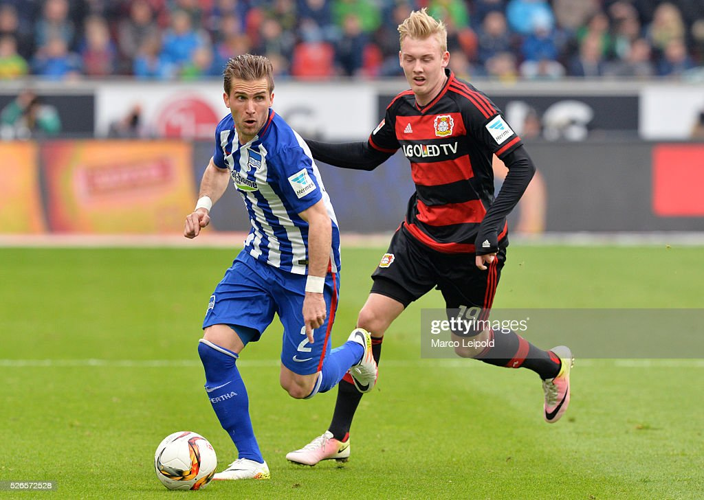 Peter Pekarik of Hertha BSC and Julian Brandt of Bayer 04 Leverkusen during the game between Bayer 04 Leverkusen and Hertha BSC on april 30, 2016 in Leverkusen, Germany.