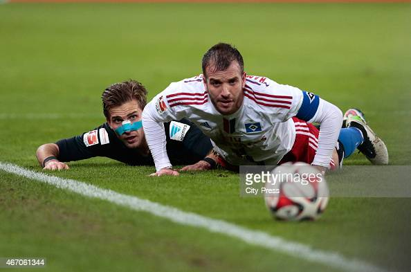 Peter Pekarik of Hertha BSC and Rafael van the Vaart of Hamburger SV battle for the ball during the match between Hamburger SV and Hertha BSC on...
